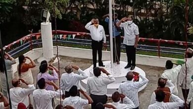 Photo of People Irked As HDUDA Chief Wears Shoes While Hoisting Flag